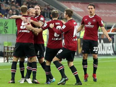 Guido Burgstaller (l.) sorgt beim 1. FC Nürnberg für Jubel