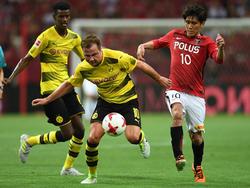 Mario Götze (M.) kann bei Borussia Dortmund wieder zu alter Stärker finden
