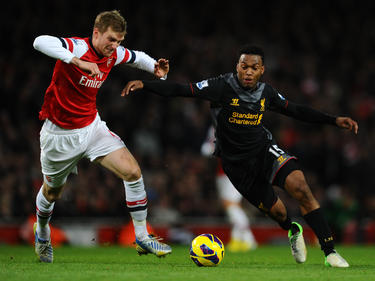 Spitzenspiel: Gelingt Per Mertesacker (l.) mit Arsenal die Tabellenführung gegen Liverpool zu behaupten?