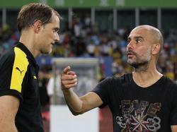 Thomas Tuchel und Pep Guardiola (r.) könnten im Achtelfinal aufeinandertreffen