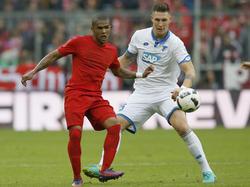 Niklas Süle (r.) spielt ab Sommer mit Douglas Costa zusammen