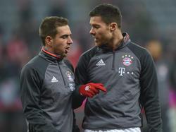 Philipp Lahm (l.) und Xabi Alonso werden ihre Karrieren beim FC Bayern wohl beenden