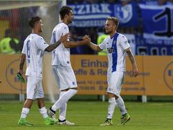 Christian Beck (M.) steht mit dem 1. FC Magdeburg in der zweiten Runde