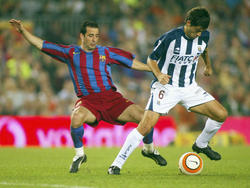 Ludovic Giuly en un encuentro de 2005 con la camiseta azulgrana. (Foto: Getty)