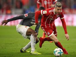 Der FC Bayern München kann sich auf ihn verlassen: Torjäger Robert Lewandowski (r.)