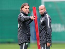 Martin Schmidt (li.) will den VfL Wolfsburg zurück in die Erfolgsspur führen