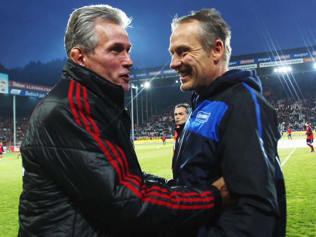 Christian Streich (re.) erwartet gegen Heynckes' FCB ein hartes Stück Arbeit