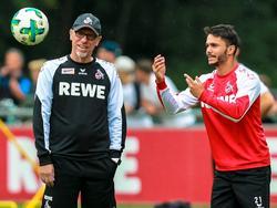 Kölns Trainer Peter Stöger (l.) und Leonardo Bittencourt