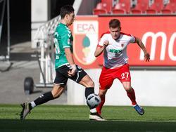 AlfreðFinnbogason (r.) spielte zuletzt vor sechs Monaten für den FC Augsburg