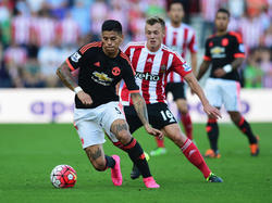 Marcos Rojo (l.) will bei Manchester United bleiben