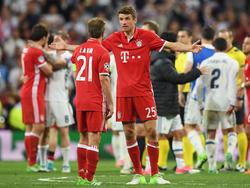 Philipp Lahm und Thomas Müller diskutieren über das Viertelfinal-Aus