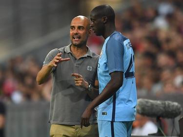 Yaya Touré (r.) und City-Trainer Pep Guardiola
