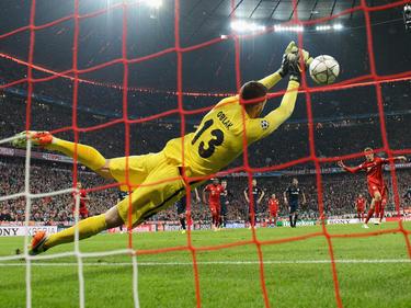 Oblak parando el penalti de Müller en la semifinal de la Champions. (Foto: Getty)
