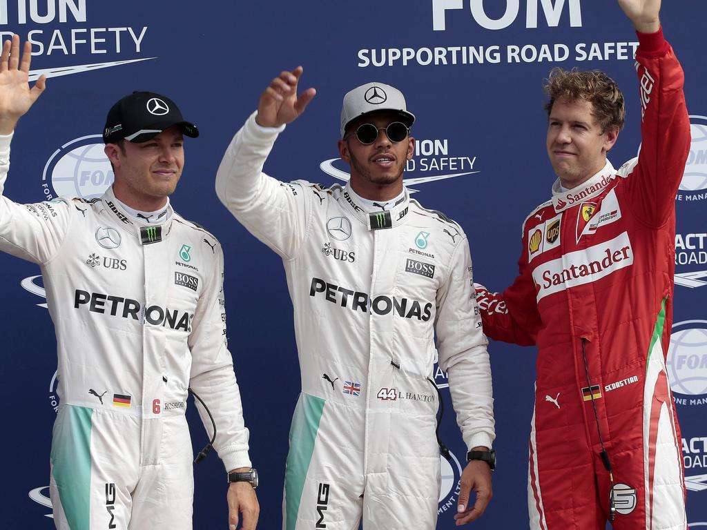 Sebastian Vettel (r.) würde gerne mit Nico Rosberg (l.) tauschen