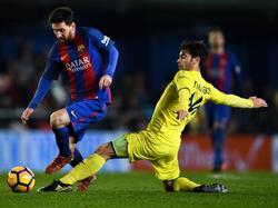Lionel Messi (l.) konnte dem FC Barcelona einen Punkt gegen Villarreal retten