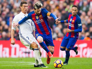 Cristiano Ronaldo (l.) und Lionel Messi fechten wieder einmal die Meisterschaft aus