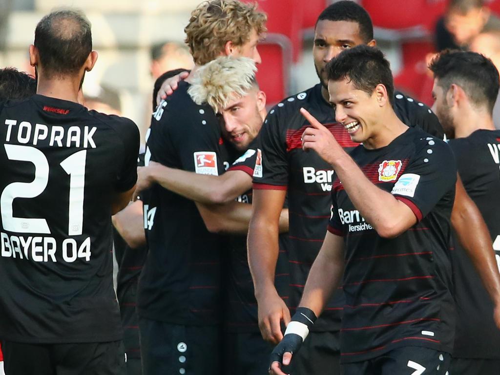 Die Leverkusener mit Chicharito (v.) müssen gegen Monaco punkten