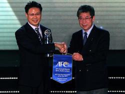 Zhan Jian (l.) möchte China im internationalen Fußball etablieren