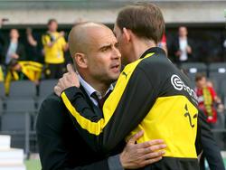 Münchens ehemaliger Trainer Josep Guardiola (l) soll sich Thomas Tuchel als Nachfolger gewünscht haben.