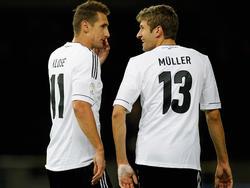 Miroslav Klose (l.) glaubt trotz Torflaute an Thomas Müller