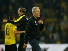 Christian Streich (vorne) hofft auf Tuchel und den BVB