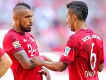 Arturo Vidal (l.) und Thiago fehlen den Bayern